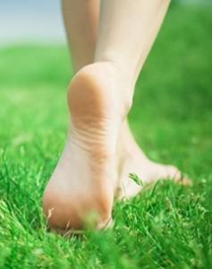Bare feet enjoying walking in the grass